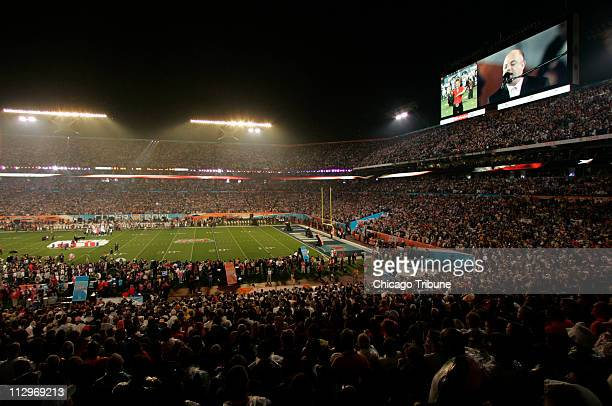 Billy Joel is shown on the big screen as the crowd listens to the National Anthem before Super Bowl XLI in Miami Florida on Sunday February 4 2007