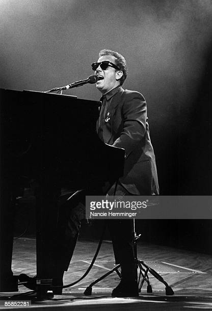 Billy Joel performing on stage in New York piano sunglasses