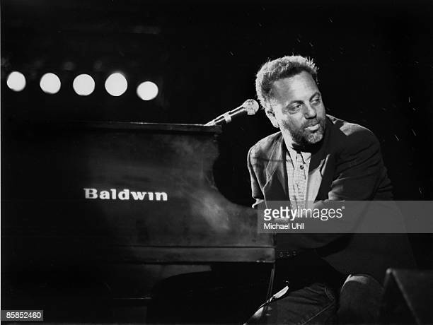 Photo of Billy JOEL Billy Joel performing on stage at Baldwin piano