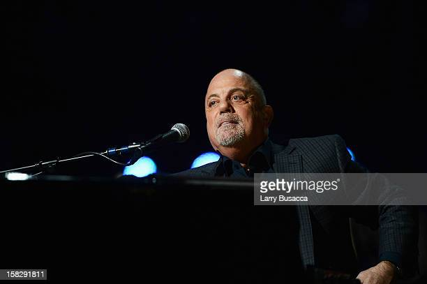Billy Joel performs at '121212' a concert benefiting The Robin Hood Relief Fund to aid the victims of Hurricane Sandy presented by Clear Channel...