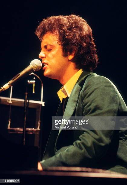 Billy Joel performs on stage, USA, 1977.
