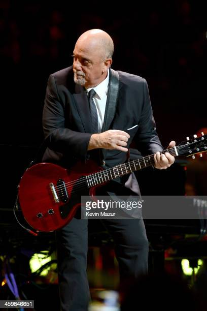 Billy Joel performs onstage during his New Year's Eve Concert at the Barclays Center of Brooklyn on December 31 2013 in New York City