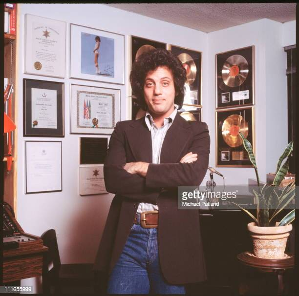 Billy Joel, portrait, at home in front of gold discs, New York, 25th January 1978.