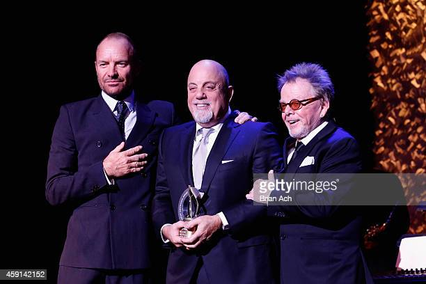 Billy Joel receives an award onstage with Sting and Paul Wiliams at the ASCAP Centennial Awards at Waldorf Astoria Hotel on November 17 2014 in New...