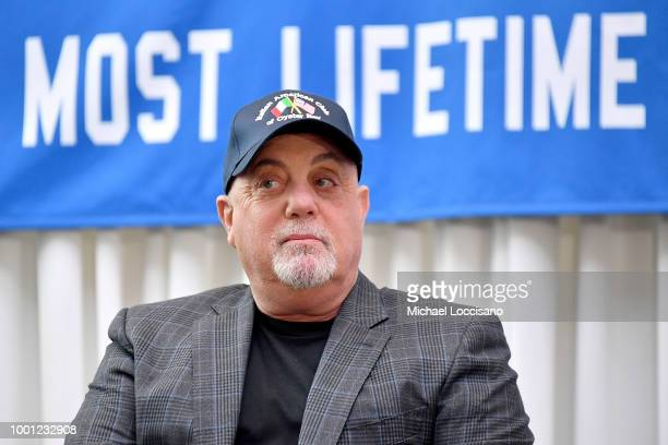 Billy Joel sits in front of the banner at a press conference honoring his 100th Lifetime Performance at Madison Square Garden on July 18 2018 in New...