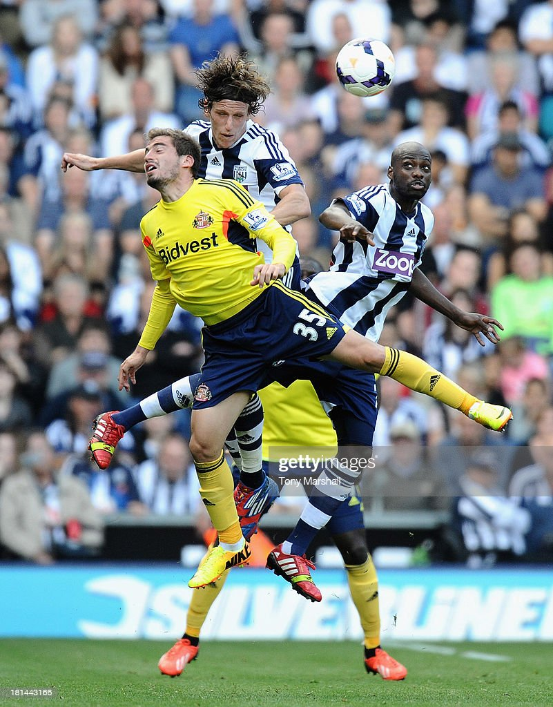 Billy Jones and Stephane Sessegnon of West Bromwich Albion challenge Charis Mavrias of Sunderland during the Barclays Premier League match between West Bromwich Albion and Sunderland at The Hawthorns on September 21, 2013 in West Bromwich, England.
