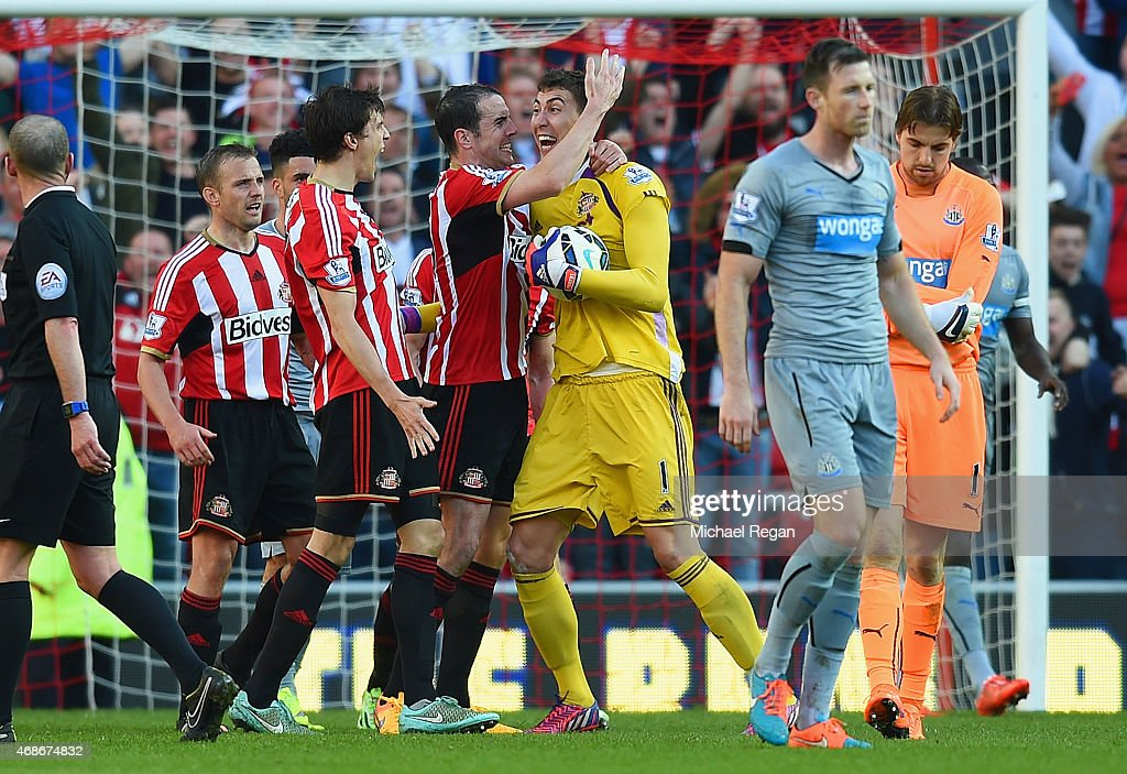 Billy Jones, John O'Shea and Costel Pantilimon of Sunderland celebrate victory at the final whistle during the Barclays Premier League match between Sunderland and Newcastle United at Stadium of Light on April 5, 2015 in Sunderland, England.