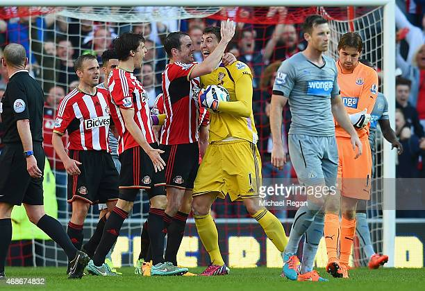Billy Jones John O'Shea and Costel Pantilimon of Sunderland celebrate victory at the final whistle during the Barclays Premier League match between...