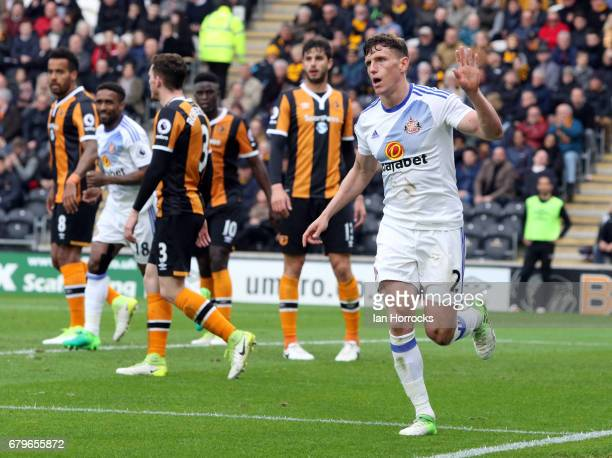 Billy Jones of Sunderland celebrates after he opens the scoring with a diving header during the Premier League match between Hull City and Sunderland...