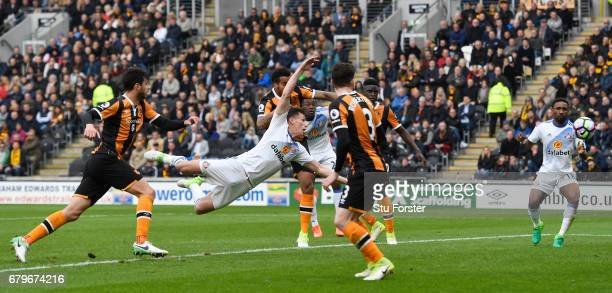 Billy Jones of Sunderland scores his sides first goal with a diving header during the Premier League match between Hull City and Sunderland at the...