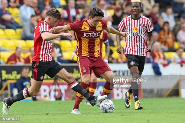 Billy Jones of Sunderland tries to halt Alex Gilliead of Bradford during a preseason friendly match between Bradford City and Sunderland AFC at the...