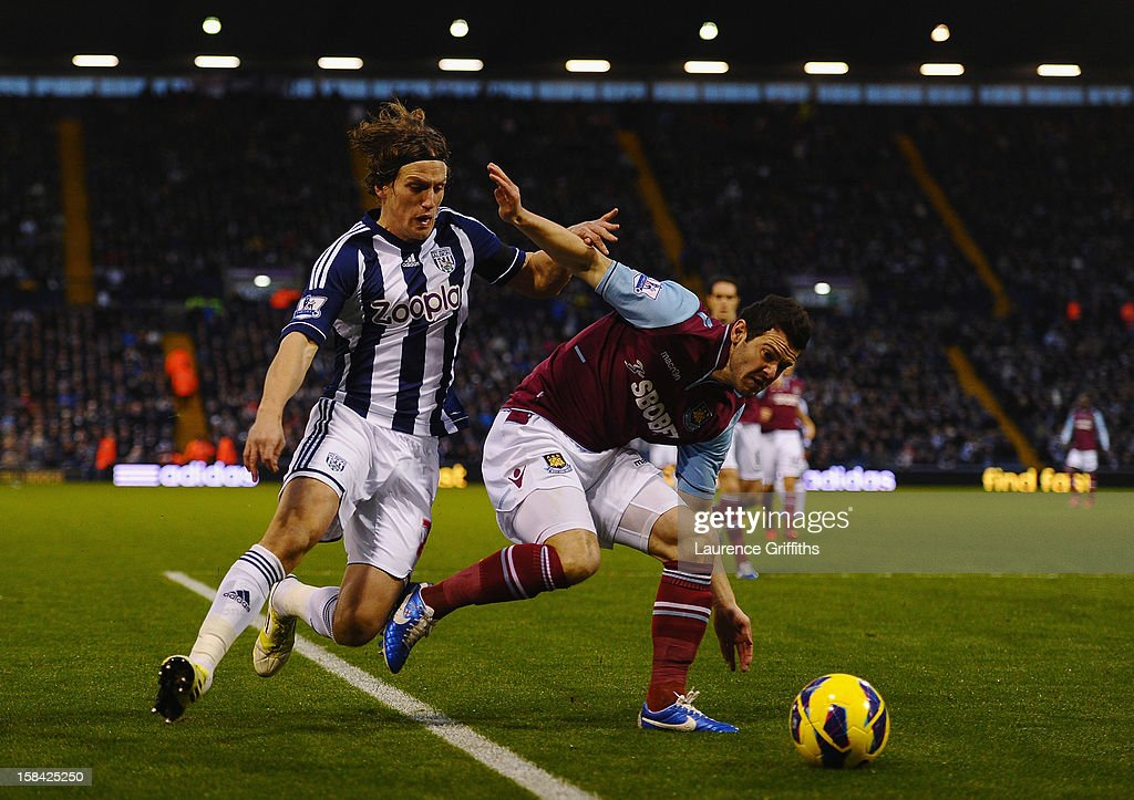 Billy Jones of West Brom battles with Matt Jarvis of West Ham during the Barclays Premiership match between West Bromwich Albion and West Ham United at The Hawthorns on December 16, 2012 in West Bromwich, England.