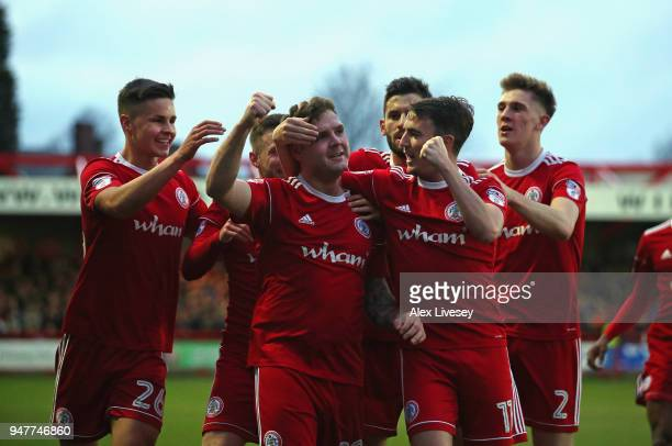 Billy Kee of Accrington Stanley celebrates after scoring his first goal with team mates during the Sky Bet League Two match between Accrington...