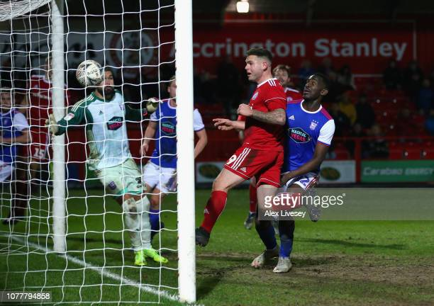 Billy Kee of Accrington Stanley scores his team's first goal past Bartosz Bialkowski of Ipswich Town during the FA Cup Third Round match between...