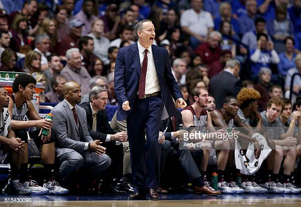 Billy Kennedy the head coach of the Texas AM Aggies gives instructions to his team against the Kentucky Wildcats during the Championship Game of the...