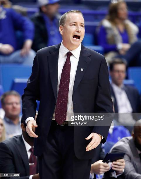 Billy Kennedy the head coach of the Texas AM Aggies gives instructions to his team against the Kentucky Wildcats during the game at Rupp Arena on...