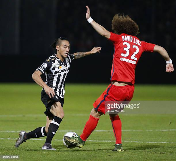 Billy Ketkeophomphone of SCO Angers and David Luiz of PSG in action during the French Ligue 1 match between Angers SCO and Paris SaintGermain at...