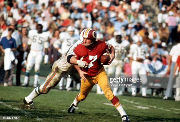 Billy Kilmer of the Washington Redskins attempts to scramble away from the pressure of the Miami Dolphins defense during Super Bowl VII at the Los...