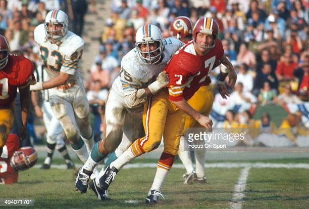 Billy Kilmer of the Washington Redskins gets his pass off under pressure from Manny Fernandez of the Miami Dolphins during Super Bowl VII at the Los...