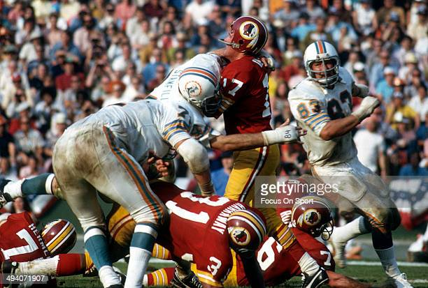 Billy Kilmer of the Washington Redskins gets his pass off under pressure from Bill Stanfill of the Miami Dolphins during Super Bowl VII at the Los...