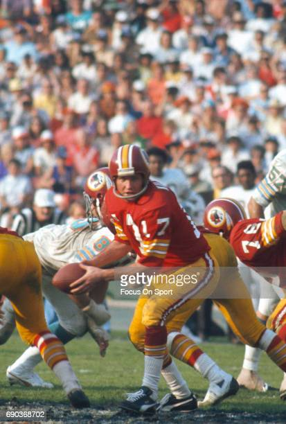 Billy Kilmer of the Washington Redskins in action against the Miami Dolphins during Super Bowl VII at the Los Angeles Memorial Coliseum in Los...