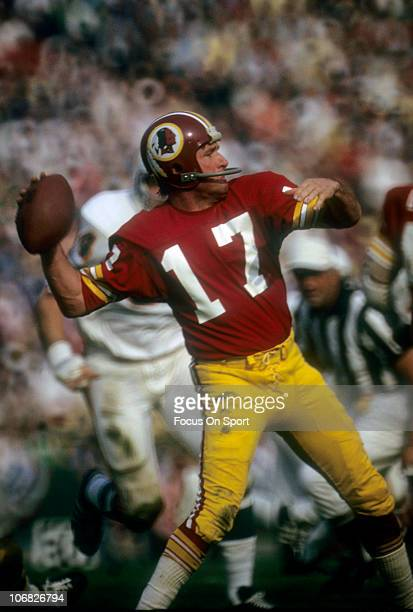 Billy Kilmer of the Washington Redskins throws a pass against the Miami Dolphins during Super Bowl VII at the Memorial Coliseum January 14 1973 in...