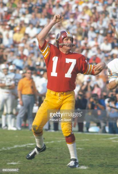 Billy Kilmer of the Washington Redskins throws a pass against the Miami Dolphins during Super Bowl VII at the Los Angeles Memorial Coliseum in Los...