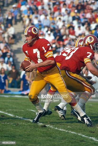 Billy Kilmer of the Washington Redskins turns to hand the ball off to a running back against the Miami Dolphins during Super Bowl VII at the Los...