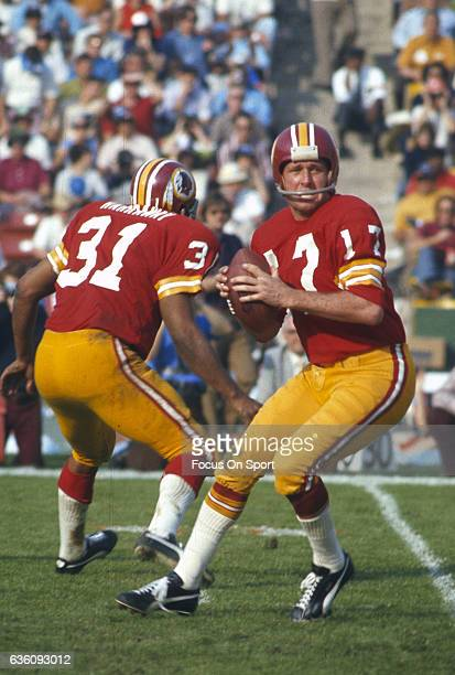 Billy Kilmer Washington Redskins drops back to pass against the Miami Dolphins during Super Bowl VII at the Los Angeles Memorial Coliseum in Los...