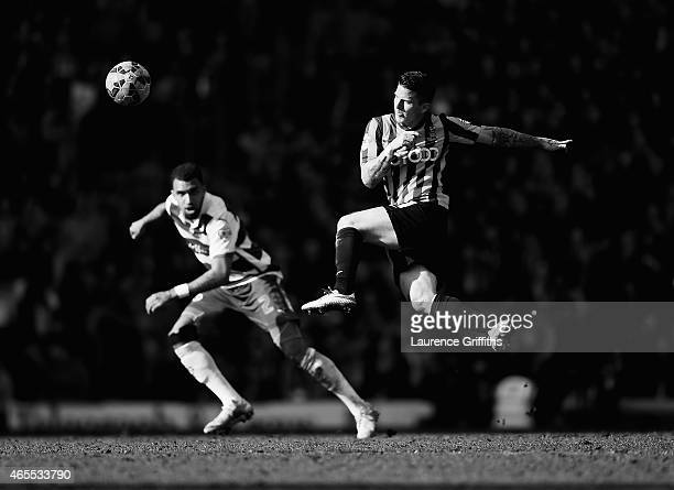 Billy Knott of Bradford City strikes the ball as Daniel Williams of Reading closes during the FA Cup Quarter Final betweeen Braford City and Reading...