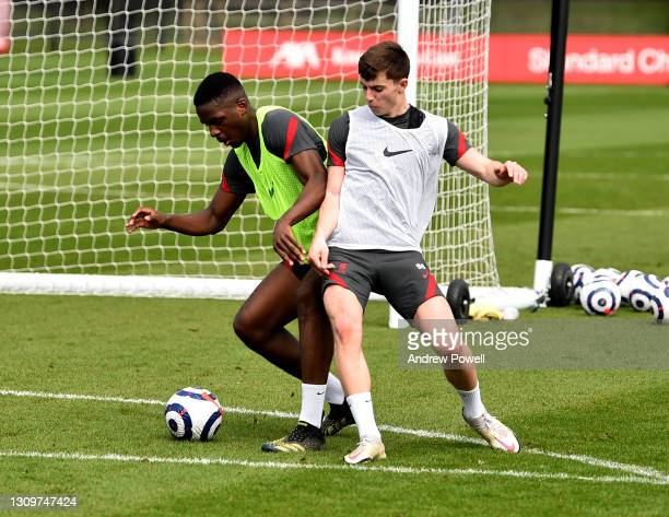 Billy Koumetio and Ben Woodburn of Liverpool during a training session at AXA Training Centre on March 29, 2021 in Kirkby, England.