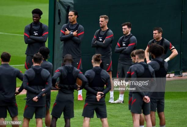 Billy Koumetio Virgil van Dijuk Jordan Henderson Andy Robertson and James Milner of Liverpool during a training session at Melwood Training Ground on...