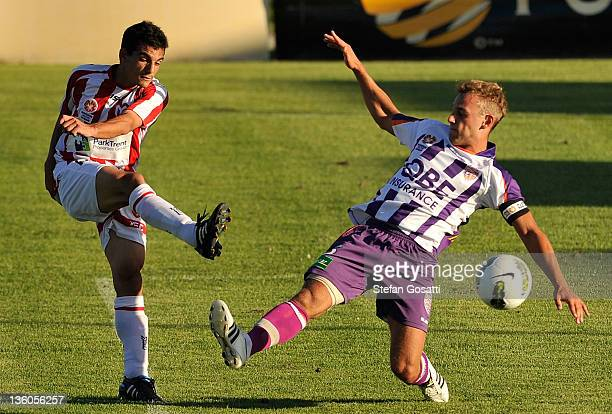 Billy Liolios of the Heart kicks the ball past Clayton Arnez of the Glory during the round nine Youth League match between the Perth Glory and the...