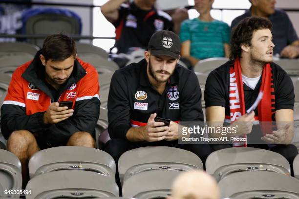 Billy Longer Josh Bruce and Dylan Roberton of the Saints look on from the stands during the round five AFL match between the St Kilda Saints and the...