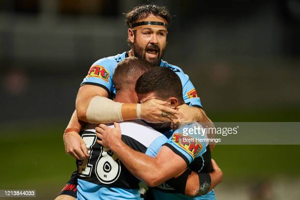 Billy Magoulias of the Sharks celebrates scoring a try with team mates during the round 2 NRL match between the Cronulla Sharks and the Melbourne...