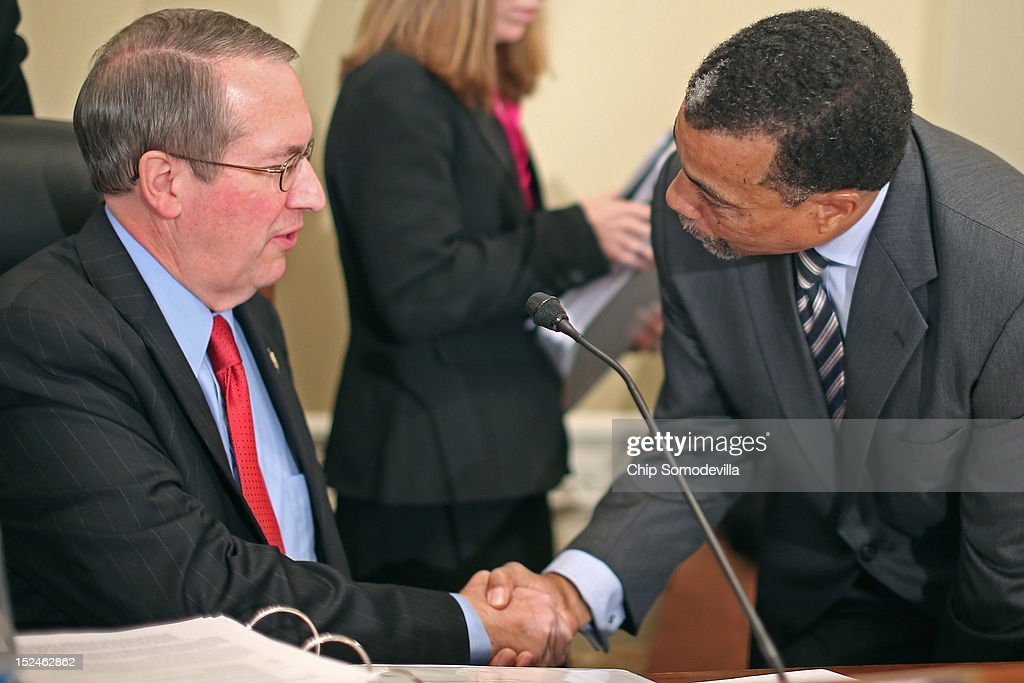 Billy Martin (R), a Washington lawyer, and House Committee on Ethics Acting Chairman Bob Goodlatte (R-VA) shake hands before a rare open hearing about the investigation of wrongdoing by Rep. Maxine Waters (D-CA) and her Chief of Staff and grandson Mikael Moore, in the Longworth House Office Building on Capitol Hill September 21, 2012 in Washington, DC. The long-running investigation found that Waters did not commit an ethics violaiton when her office in late 2008 set up a meeting with top Treasury Department officials on behalf of a bank Williams owned stock in, at a time when the bank faced possible collapse because of the financial crisis. However, Moore was issued a letter of reproval for three ethics violations for trying to help the bank.