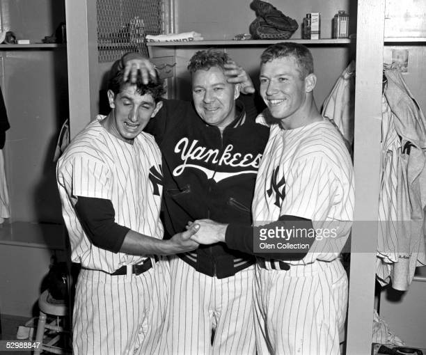 Billy Martin Eddie Lopat and Mickey Mantle of the New York Yankees celebrate after Game 2 of the World Series on October 1 1953 against the Brooklyn...