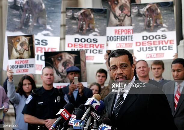 Billy Martin foreground lead attorney for Michael Vick quarterback for the Atlanta Falcons speaks during a news conference as protestors stand...