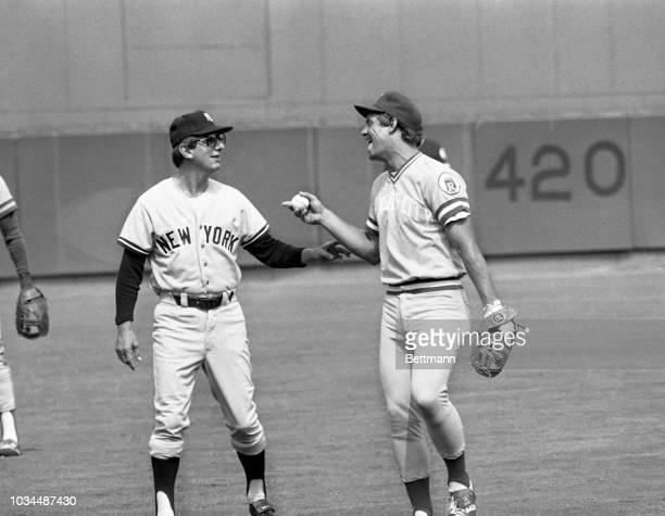 Billy Martin, manager of the New York Yankees and the manager of the American League All Stars, shares a joke with George Brett, third baseman, from...