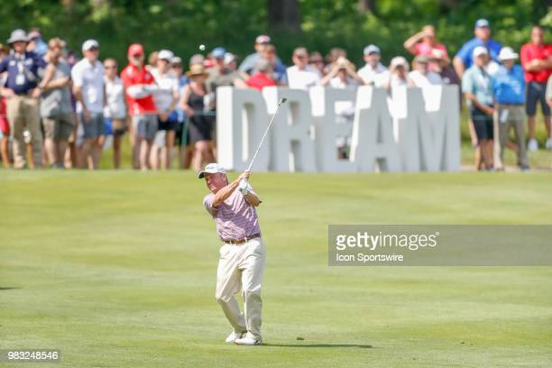 Billy Mayfair hits his second shot on eighteen during the final round of the American Family Insurance Championship Champions Tour golf tournament on...