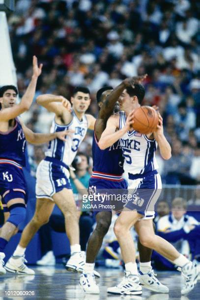 Billy McCaffrey of the Duke Blue Devils is guarded by Terry Brown of the Kansas Jayhawks during the 1991 NCAA Photos via Getty Imagess via Getty...