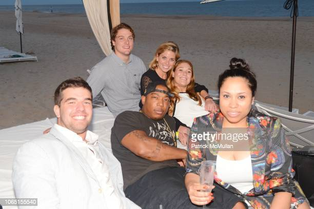 Billy McFarland Ja Rule Aisha Atkins with Guests attend Magnises Summer Bash at Gurney's Inn on July 26 2014 in Montauk NY