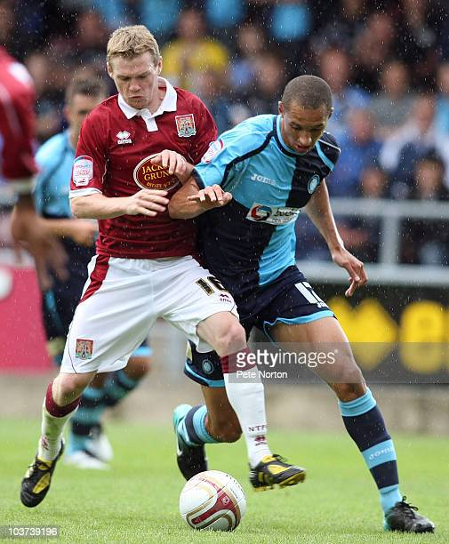 Billy McKay of Northampton Town contests the ball with Lewis Montrose of Wycombe Wanderers during the npower LeagueTwo match between Northampton Town...