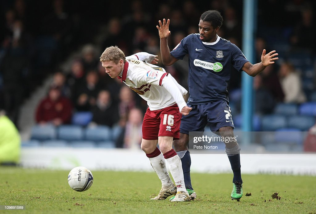 Billy McKay of Northampton Town looks to control the ball watched by Anthony Grant of Southend United during the npower League Two match between Southend United and Northampton Town at Roots Hall on February 26, 2011 in Southend, England.