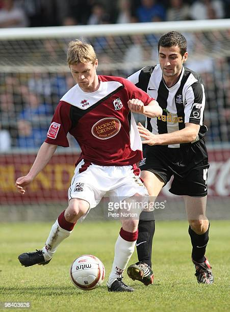 Billy McKay of Northampton Town looks to play the ball under pressure from Mike Edwards of Notts County during the Coca Cola League Two Match between...