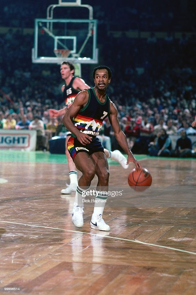 Billy McKinney #7 of the Denver Nuggets moves the ball up court against the Boston Celtics during a game played in 1983 at the Boston Garden in Boston, Massachusetts.
