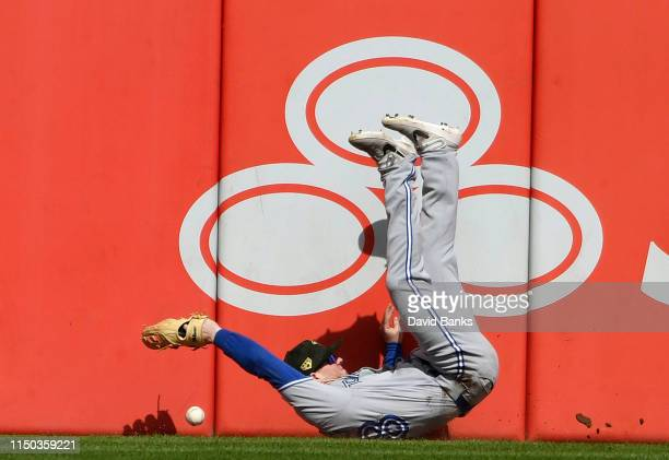 Billy McKinney of the Toronto Blue Jays can't catch a one run double hit by Jose Abreu of the Chicago White Soxduring the eighth inning at Guaranteed...