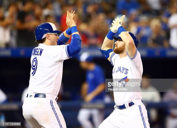Billy McKinney of the Toronto Blue Jays celebrates with Danny Jansen after hitting a 2 run home run in the fifth inning during a MLB game against the...