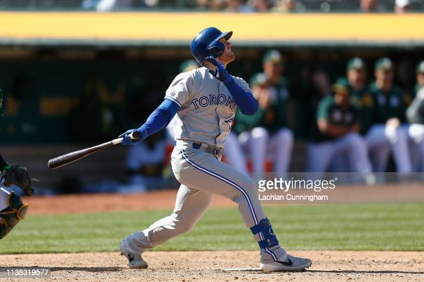 Billy McKinney of the Toronto Blue Jays hits a sacrifice fly ball to score Socrates Brito in the top of the ninth inning against the Oakland...