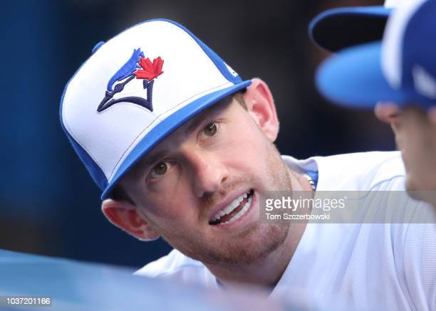 Billy McKinney of the Toronto Blue Jays looks on from the top step of the dugout during MLB game action against the Tampa Bay Rays at Rogers Centre...